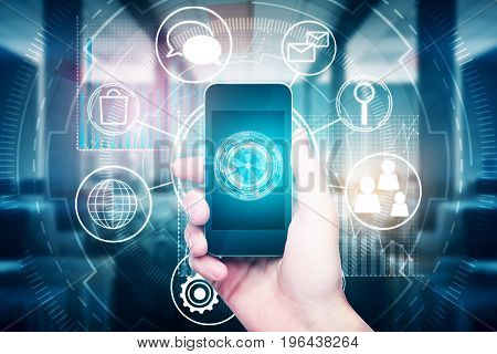 Hand holding smartphone with abstract digital business hologram in blurry office interior. Futuristic innovation concept. Double exposure
