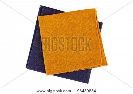 Orange and violet textile napkins isolated on white background