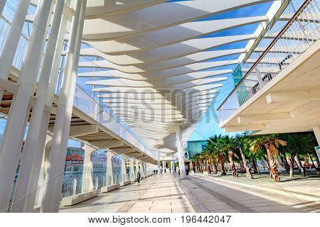 MALAGA, SPAIN - NOVEMBER 09, 2016: Palmeral de las Sorpresas promenade at Malaga port. Costa del Sol, Andalusia