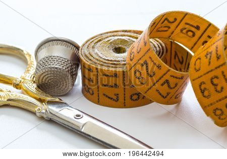 Sewing measuring tape scissors and thimble accessories for needlework and sewing hobby white background