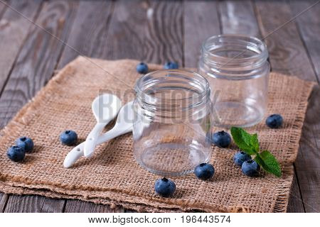 Empty jars on the table on a wooden background