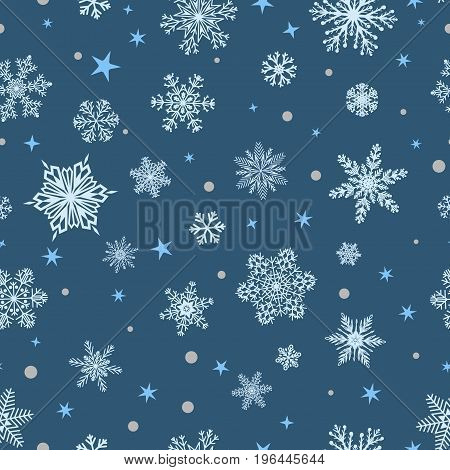 Christmas seamless pattern of big and small snowflakes white on blue