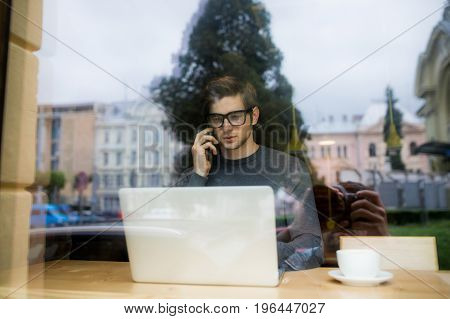 Young Man Ceo Of Big Successful Company Is Having Mobile Phone Conversation With Customers