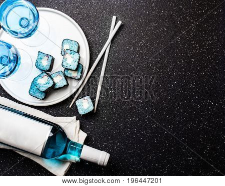 Blue Sushi Rolls And Blue Wine Chardonnay On Black Background. Spanish Blue Wine, Trendy Drink, Fanc