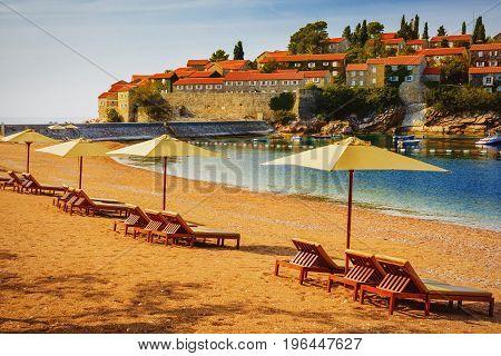 Beautiful Beach With Sunshades In Montenegro, Balkans, Adriatic Sea.