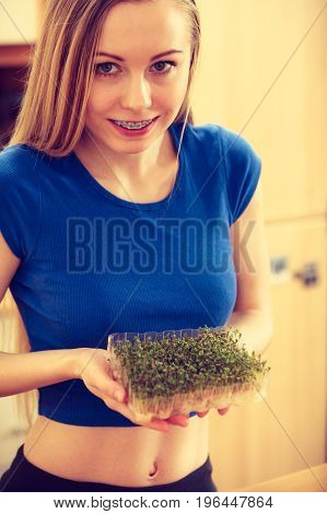 Happy Woman Holding Cuckooflower Cress