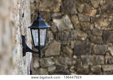 Street lights in the Old City. Against the wall