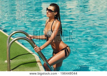 Portrait Of Beautiful Elegant Tanned Woman Relaxing In Bikini And Sunglasses In Swimming Pool Spa. H