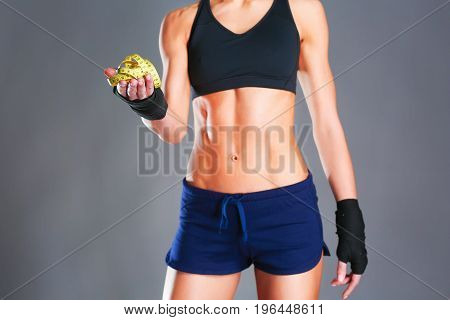 Young woman with measure tape isolated on black background