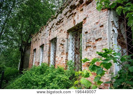 Wall with windows of the ruined temple of St. Nicholas in the village of Gribny. Russia, Tver region.