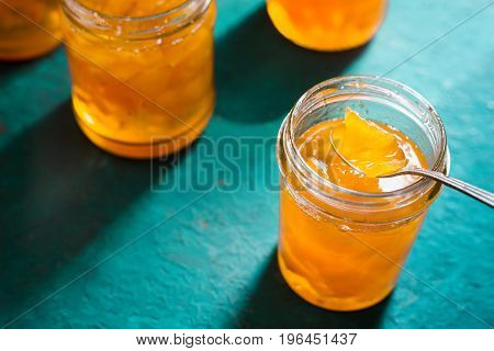 Homemade pineapple jam in glass bowl side view horizontal