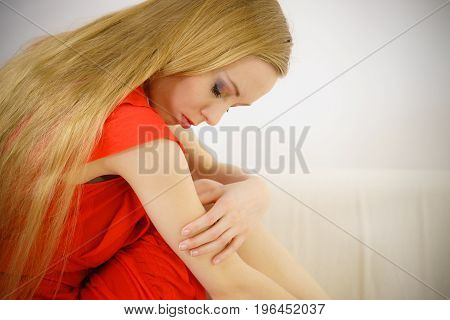 Sad Elegant Woman Sitting On Sofa
