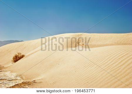 White sand dunes under blue sky, Death Valley, California