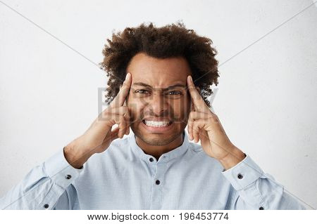 Stressed Annoyed Young African American Male With Face Screwed Up With Pain, Squeezing Temples And C