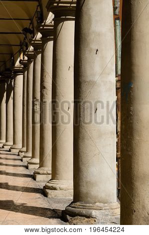 Row Of Columns On A Bologna Street Arcade, Italy