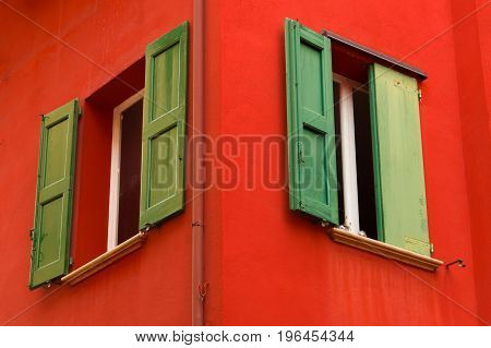 Colourful Faceade And Wooden Window Shutters, Bologna, Italy
