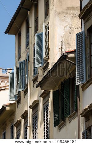 Facades With Wooden Window Shutters In Florence, Italy