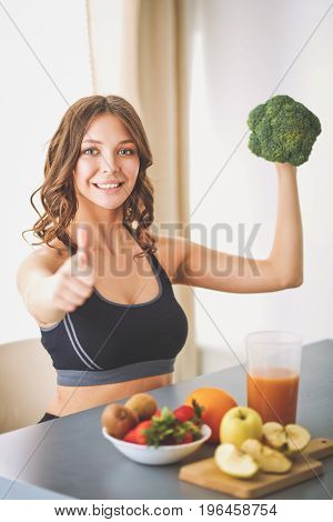 Young and beautiful woman cooking in a kitchen