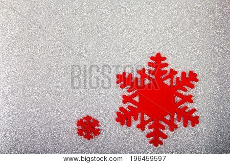 The big red snowflake on a sparkly background. Closeup