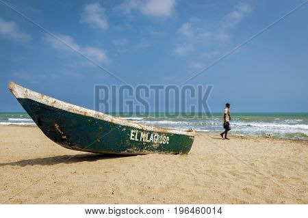 Palomino Colombia - March 13 2014: Man walking in the Palomino Beach in the Caribbean Coast of Colombia South America