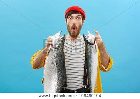 Handsome Bearded Fisherman Looking With Widely Opened Eyes And Jaw Dropped Out Angling Big Fish At R