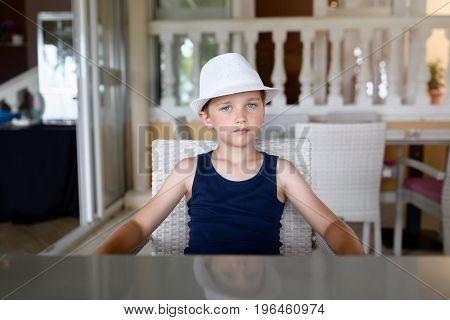 Confident Boy In Hat.