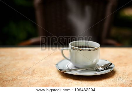 cup of invigorating morning coffee, standing on a table in a saucer