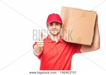 Delivery Man Showing Thumb Up And Smiling Standing Near Cardboard Boxes Isolated On White Background