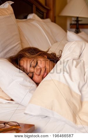 Woman getting a good nights rest in her bed.
