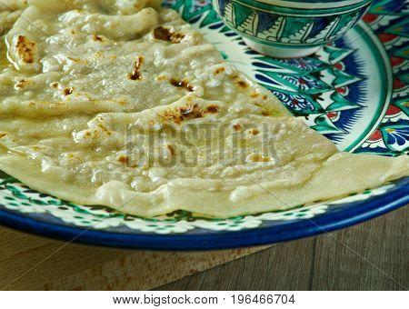 Qutab - Uzbek baked meat pastry. close up