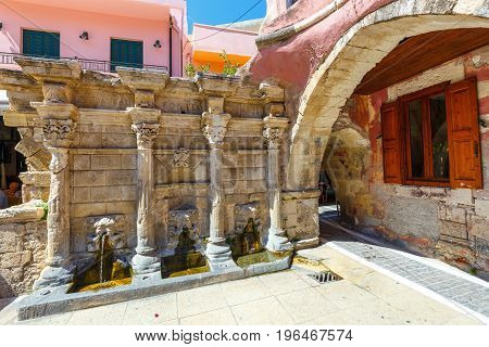 Rethymno, Crete, May 27, 2016: The Rimondi Fountain In The Centre Of The Old Town Of Rethymnon, Gree