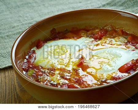 Spanish style baked tasty eggs. close up