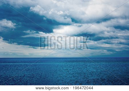 Dark clouds over the water of the sea