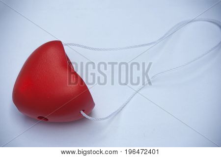 Happy Valentine Day Concept : Red hanger heart shape on white background.