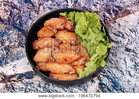 Deep Fried Chicken Wings Topped Green Oak.