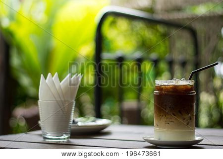 Iced coffee with milk on the wooden table