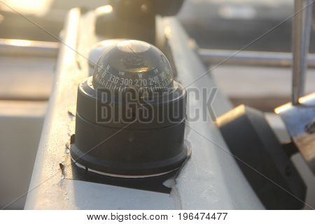 A compass on a pleasure speed boat