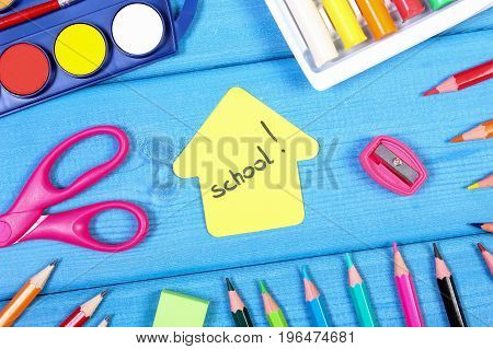 School And Office Accessories With Shape Of Building On Blue Boards, Back To School Concept
