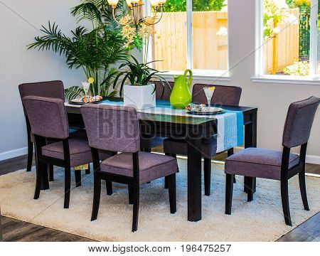 Modern Dining Room Table With Purple High Back Chairs