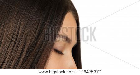 Girl with shiny hair and closed eyes close-up. Beautiful profile portrait of white girl isolated on whie background.