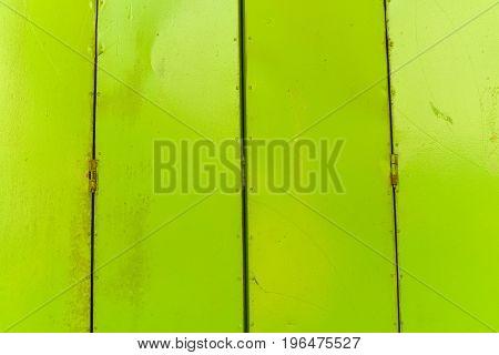 Antique Slide Steel Door Locked.vintage Style Of Close Steel Door. The Old Rusty Steel Door.