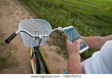 Cyclist Using Navigator On Your Smartphone,