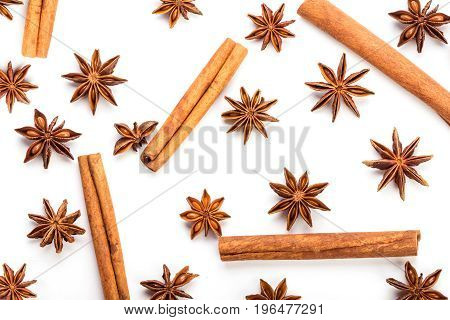 star anise spice and cinnamon stick pattern decoration on white background