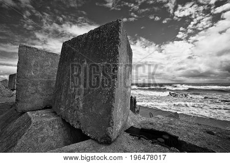 Monochrome image of the Baltic Sea with stone breakwaters