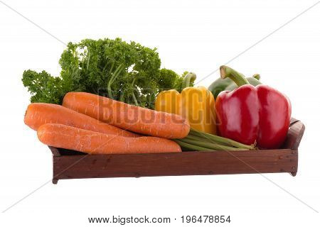 Yellow Red Green Pepper Carrot And Parsley In A Basket Isolated On A White Background