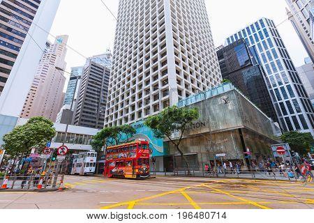 Tram And Walking People In Hong Kong