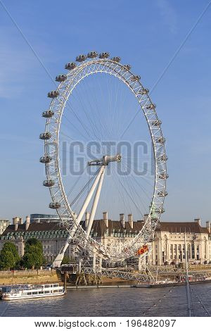 LONDON UNITED KINGDOM - JUNE 21 2017: View on London Eye on a sunny day. It was erected in 1999 is the most popular paid tourist attraction in the UK with over 3.75 million visitors annually
