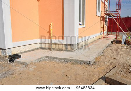 Insulation with waterproof membraneinsulation stucco for house foundation construction. House foundation repair insulation with plastic drainage for rain chain pipe. Foundation waterproofing.