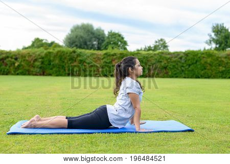 Teenage Girl Practising Yoga Outdoors