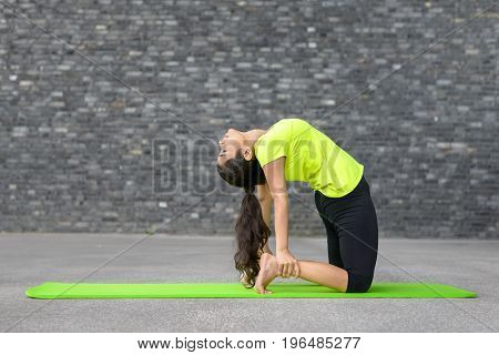 Young Indian Woman Working Out Doing Yoga